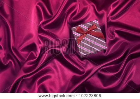 Gift Box On Satin Background