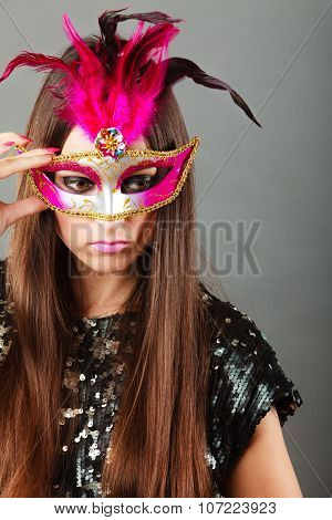 Woman Face With Carnival Mask On Gray