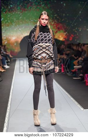 ZAGREB, CROATIA - OCTOBER 31, 2015: Fashion model wearing clothes designed by Marina Design and a bag designed by Marija Ivankovic on the 'Fashion.hr' fashion show