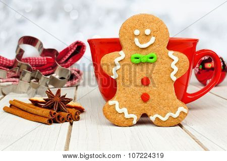 Christmas gingerbread man cookie with hot chocolate and twinkling background