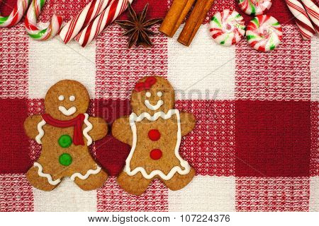 Gingerbread cookie couple on a red and white checked cloth