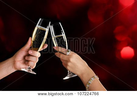 Celebration. Couple holding glasses of champagne making a toast. Space for text.
