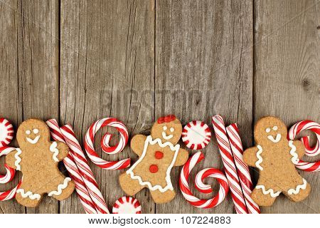Christmas gingerbread cookies, and peppermints on rustic wood