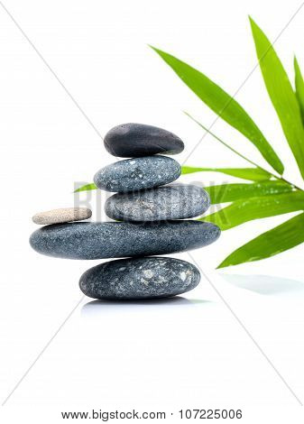 The Stacked Of Stones Spa Treatment Scene And Bamboo Leaves With Raindrop Zen Like Concepts.
