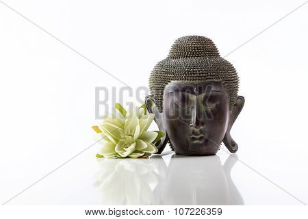 Buddha head on a white background and lotus