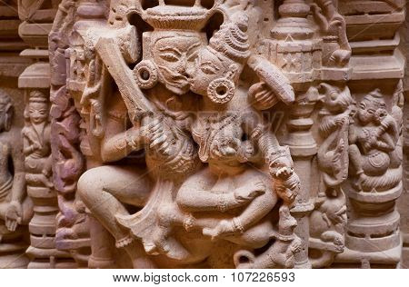 Kiss Of The Gods On Carved Wall Of Sandstone Bas-relief In 12Th Century Jain Temples, India.