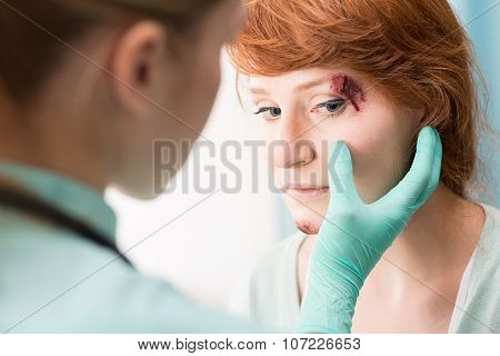 Doctor Medicating Eye Wound