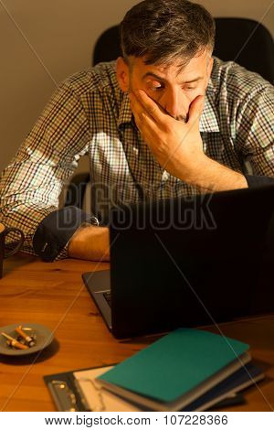 Tired Male Working On Computer