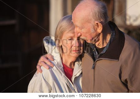 Man Comforting Sad Woman