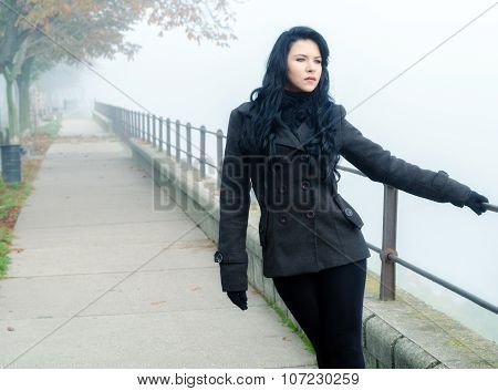 Beautiful Lonely Girl Walking In The Park On Misty Autumn Day