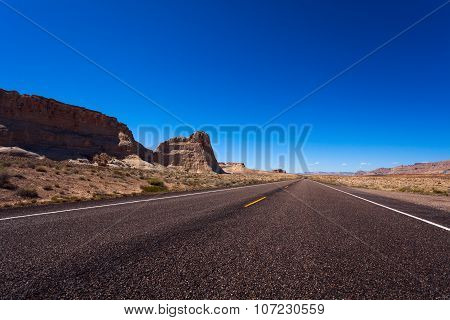 Road with rocks on left side, Death valley desert