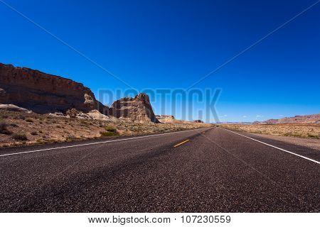 Road with rocks on left side, Death valley desert