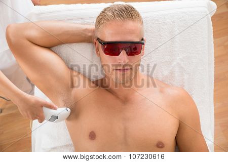 Man Receiving Laser Epilation Treatment