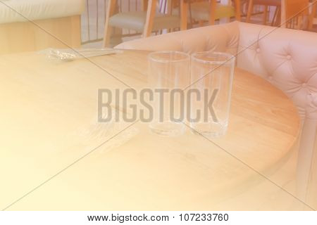 Beige Leather Armchair And Glass On Wooden Table