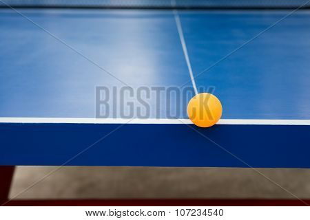 Pingpong Ball Hits The Edge Of A Blue Pingpong Table