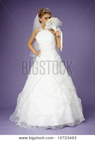 Bride In White Dress With Bouquet