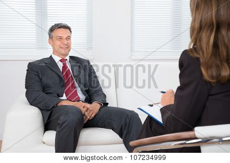 Patient On Couch In Front Of Female Psychiatrist
