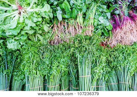 Assorted Green Vegetables At Market Display.