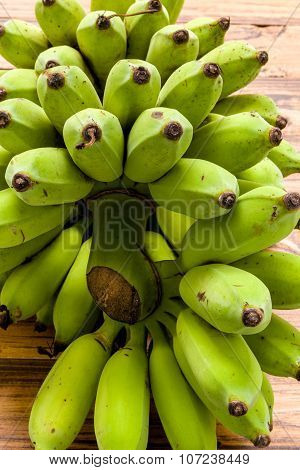 Unripe Banana / Green Unripe Banana / Unripe Banana On Wooden Background