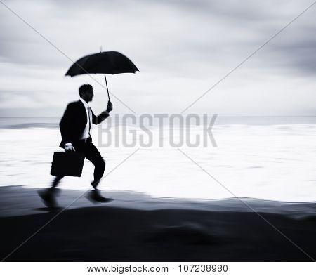 Worried Businessman Running Beach Concept
