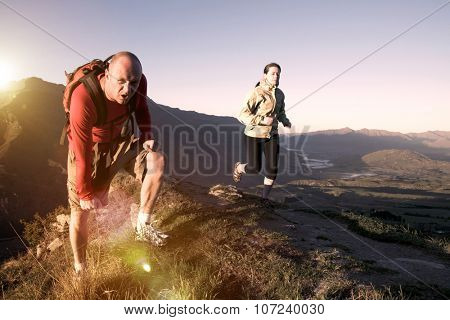 Extreme Athletes Exercising in the Mountains Concept
