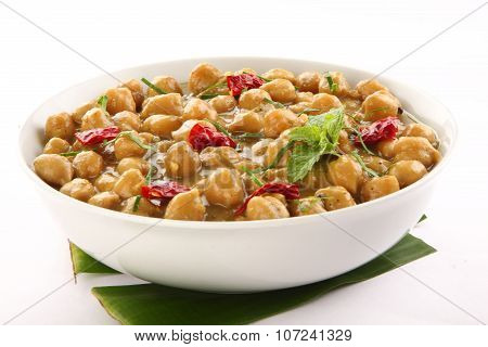 Bowl of mild spicy channa curry dish.