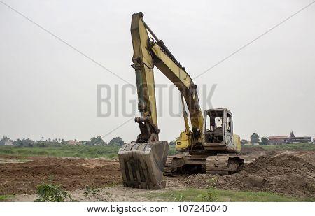 Backhoe Excavator Is Parking In Mekhong To Build A Dam At Buengkan, Thailand