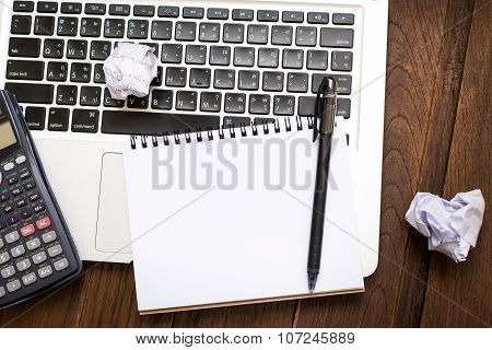 Notebook An Address Book With Blank Sheets And Calculator On The Laptop. Business A Concept Idea