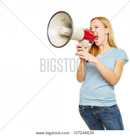 Young blonde woman shouting loudly with a big megaphone