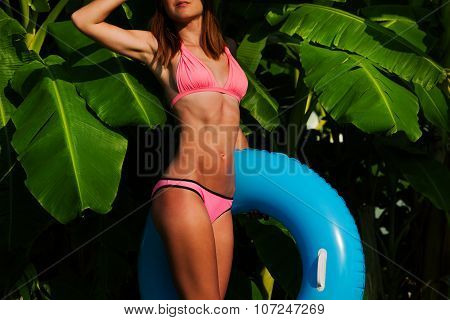 Slim and ready to play in the pool woman