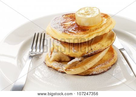 fluffy ricotta pancakes with banana isolated on white background