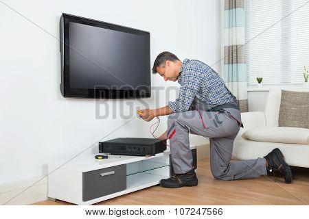 Technician Installing Tv Set Top Box At Home
