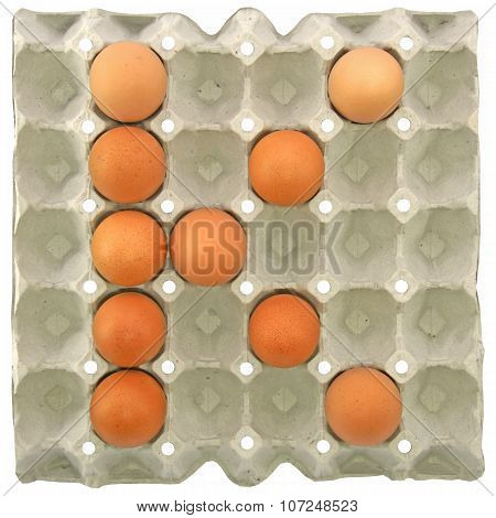 A Letter K From The Eggs In Paper Tray