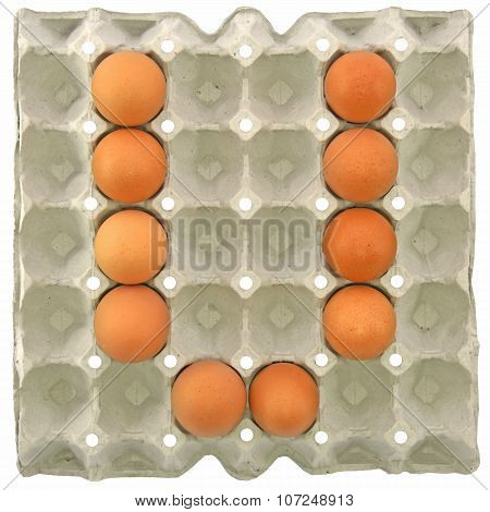 A Letter V From The Eggs In Paper Tray