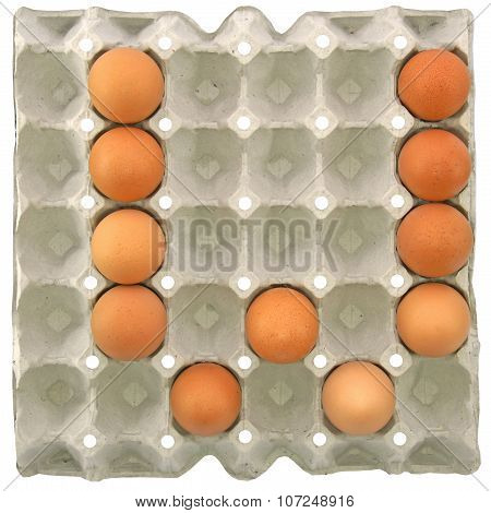 A Letter W From The Eggs In Paper Tray