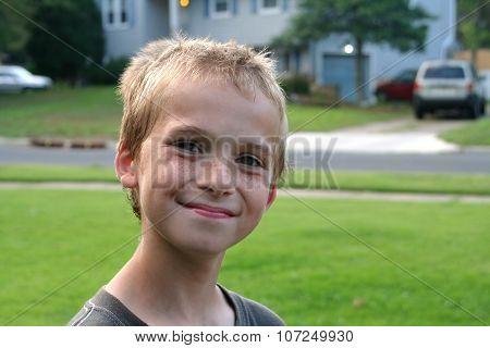Happy Boy In Residential Neighborhood