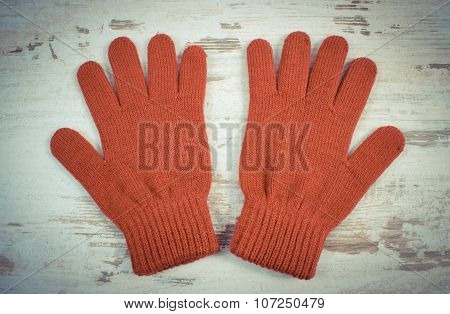 Vintage Photo, Pair Of Woolen Gloves For Woman On Old Wooden Background