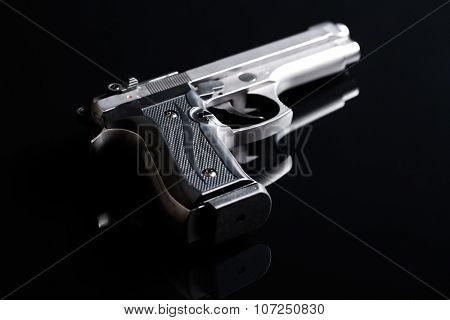 the handgun on black background