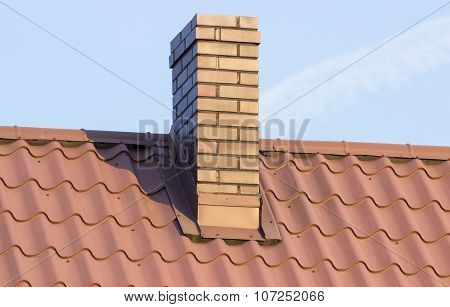Brown Chimney On Roof Of House On Sunny Day