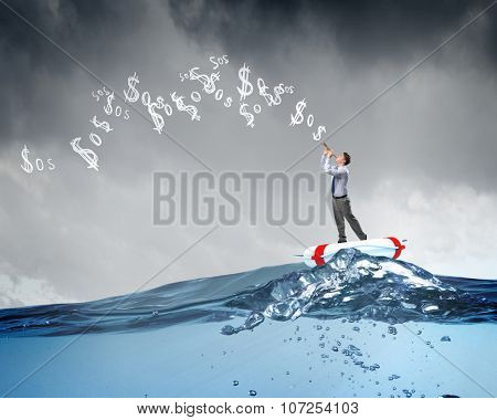 Young businessman on floating in water buoy playing pipe