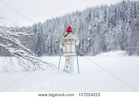 Middle-aged Woman Snowshoeing