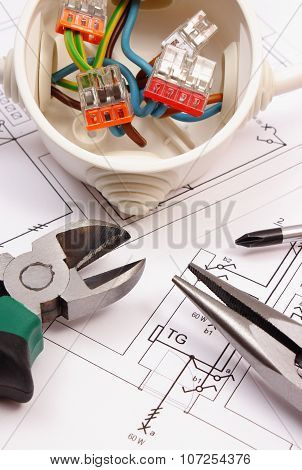 Work Tools And Electrical Box With Cables On Construction Drawing Of House