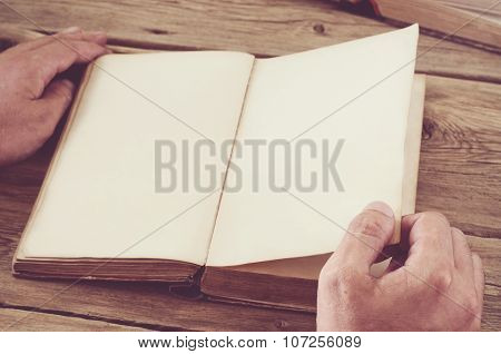 Man Turns The Page Book Close Up