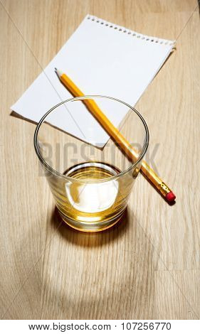 Scotch on wooden background with copyspace.