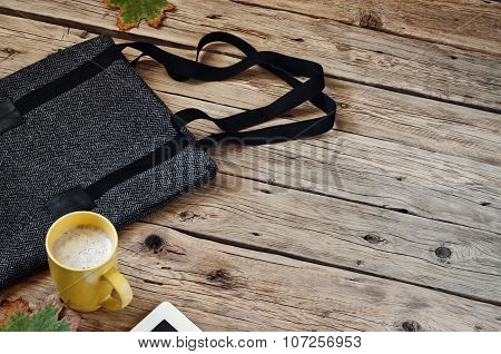 Cup Of Cappuccino With Female Woolen Bag