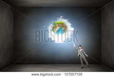 Businessman catch Earth planet with rope . Elements of this image are furnished by NASA