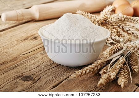 Handful Of Flour In A Ceramic Bowl Close Up