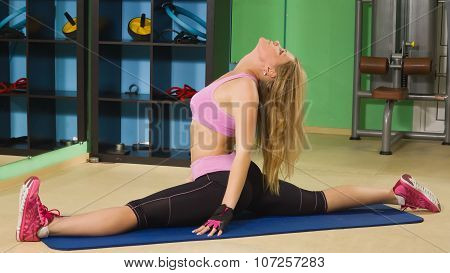 Fit Woman Exercise Sitting On Splits