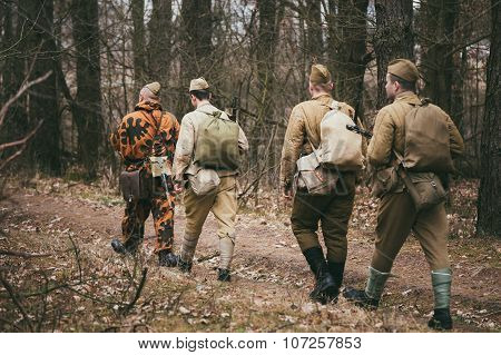 Group of unidentified re-enactors dressed as Russian Soviet sold