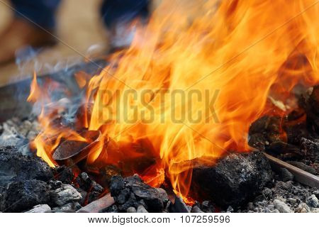 Close Up View Of Burning Coals With Bright Orange Flame In Smithy